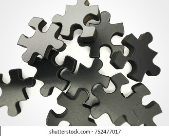 Black 3d puzzle pieces in random order with isolation. Empty white space for text.