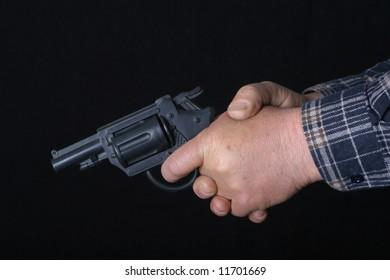 Black 9mm gun in man's hand aiming