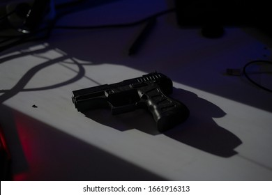the black 9mm pistol gun on the table in dark room, plan to make a crime or terror