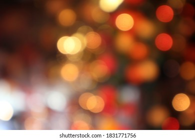 black abstract background of defocused bokeh colorful blurred beautiful shiny illuminate