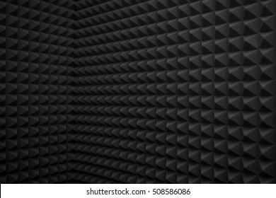 black abstract background or soundproof wall texture