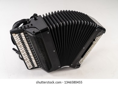 Black accordion on white background