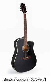 a black acoustic guitar isolated on the white
