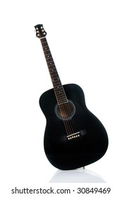 Black acoustic guitar isolated on white