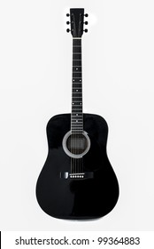 A black acoustic guitar isolated on a white background