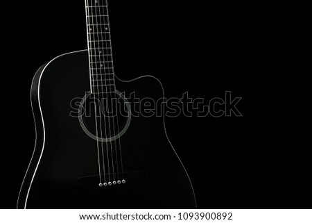 Black Acoustic Guitar On Black Background Stock Photo Edit Now