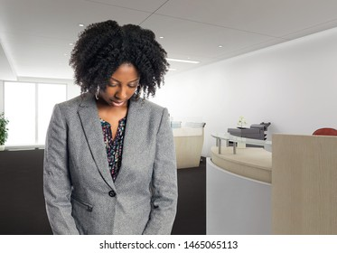 Black African American businesswoman in an office looking sad or depressed.  She is an owner or an executive of the workplace.  Depicts careers and startup business.