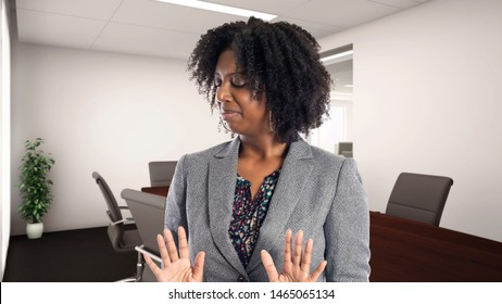 Black African American businesswoman in an office looking disgusted.  She is an owner or an executive of the workplace.  Depicts careers and startup business.