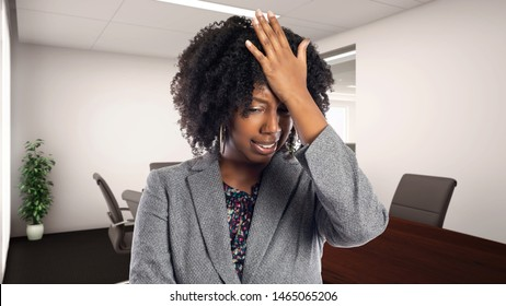 Black African American businesswoman in an office making a mistake.  She is an owner or an executive of the workplace.  Depicts careers and startup business.