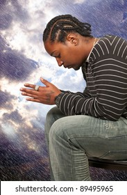 Black African American Christian man in deep prayer