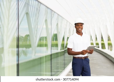 Black, African American engineer architect with digital tablet computer