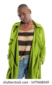 Black African American fashion model with bald hairstyle confidently posing with a vibrant lime green colored jacket for fall collection.  Depicts fashion design and clothing apparel