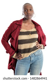 Black African American fashion model with bald hairstyle confidently posing with a red colored jacket for fall collection.  Depicts fashion design and clothing apparel