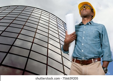 Black African American male construction worker a job site.