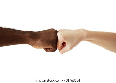 Black African American man touching knuckles with white Caucasian woman in agreement, partnership and cooperation. Two people of different cultures and races greeting each other in modern handshake