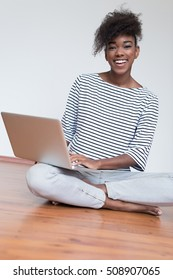 Black African American student girl using a laptop