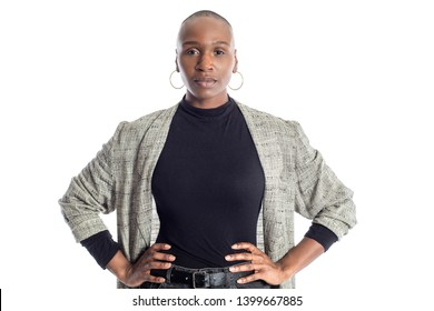 Black African American woman looking confident while wearing modern business casual outfit on a white background.  The businesswoman is depicting bold urban fashion style.