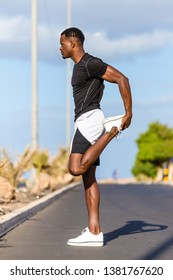 Black african american young man stretching after outdoor jogging