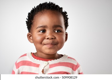 black african baby girl portrait happy smiling and laughing