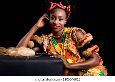 Black African female model wearing a Nigerian cultural dress in studio