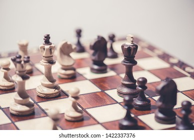 black against white chess pieces on chess board