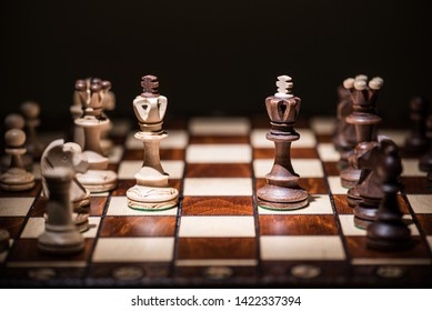 black against white king chess pieces on chess board