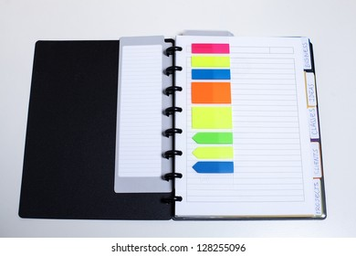 Black agenda with organizing colored elements/Perfectly organized