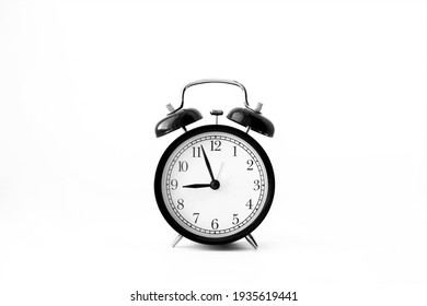 Black alarm clock isolated on white background. 9 o'clock. Morning, reminder. Time concept