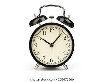Black alarm clock isolated on a white