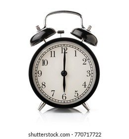 Black alarm clock isolated on white background.
