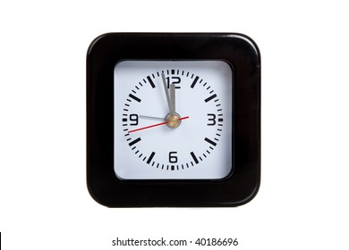 a black alarm clock on a white background