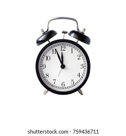 black alarm clock with white dial  against white background isolated