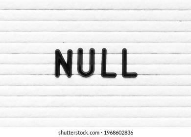 Black alphabet letter in word null on white felt board background