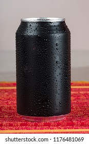 black aluminum can, with drops of water.