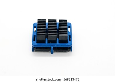 Black aluminum computer heat sink with blue plastic holder, isolated on white background.