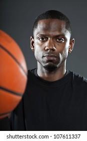 Black american basketball player. Studio portrait isolated on grey background.