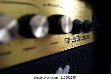 Black amplifier (amp) with golden dashboard.