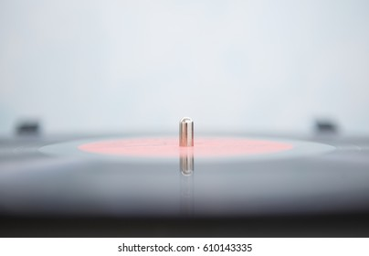 Black analog vinyl record disc with music for turntables player.Vintage hifi audio equipment for audio enthusiast&hipster.Retro record disc closeup