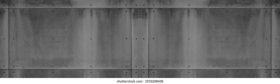 Black anthracite gray grey grunge dark wall with rivets, fiberglass concrete skin cement facade panels texture background banner panorama