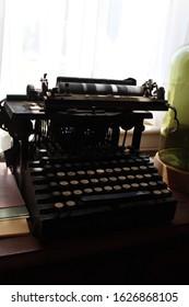 Black antique typewriter on a desk