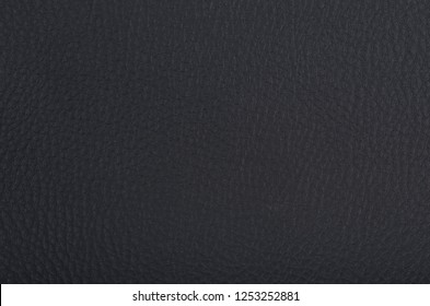 black artificial leather close-up macro thermoskin auto-tuning