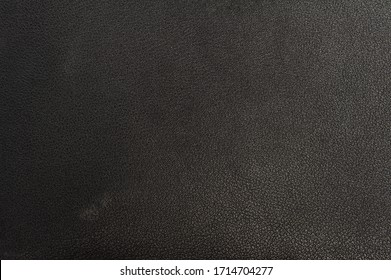 Black artificial leather texture or background