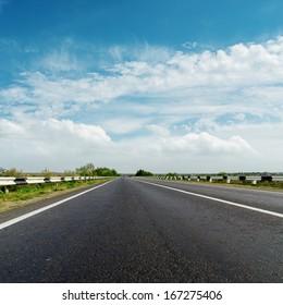 black asphalt road and cloudy horizon