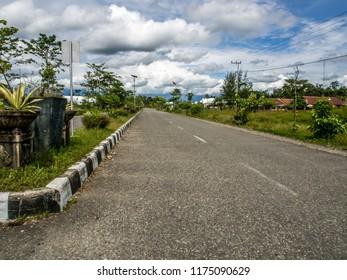 Black,  asphalt road stretching up to  horizon in Dekai West Papua. Indonesia