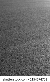 Black asphalt road surface texture