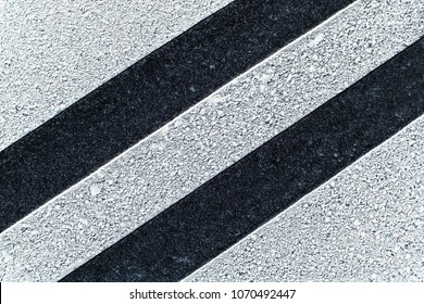 Black asphalt road white paint lines.