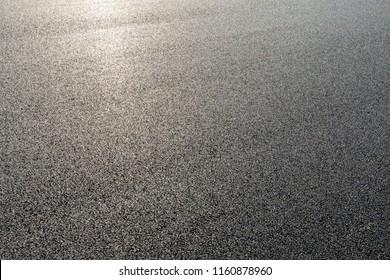 Black asphalt road,background texture close-up