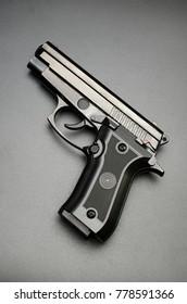 black automatic gun on black background