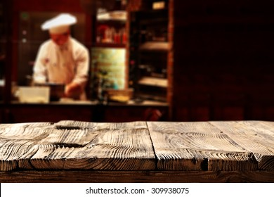black background of cook in restaurant and restaurant table and wooden top