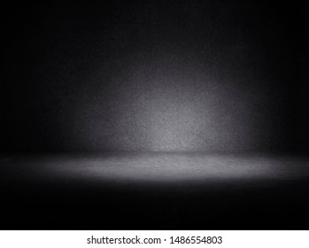 Black background.  Dark room with tile floor and wall background.